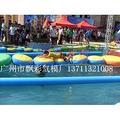 广州充气水上滚筒球厂家直销充气水上跷跷板香蕉船价格充气水上陀螺